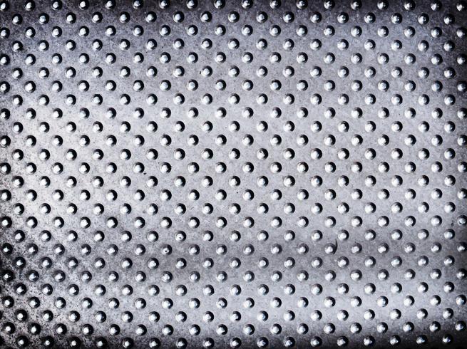 Metallisk silver prickad texturerad bakgrund