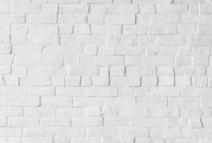 Muro de ladrillo blanco con espacio de diseño.