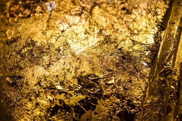 Gerimpelde gouden geweven patroonachtergrond