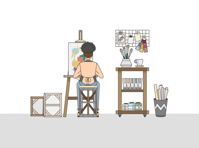 Un pintor artístico que trabaja en su estudio.