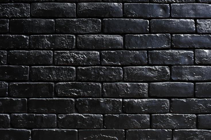 Zwarte bakstenen muur met ontwerpruimte