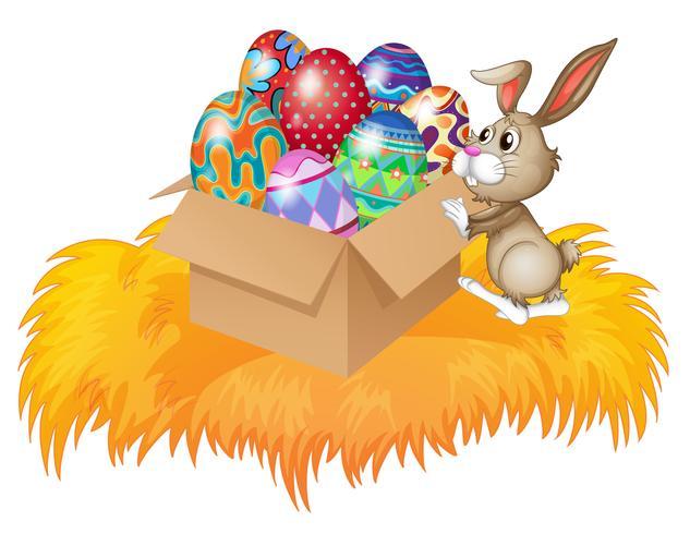 Um coelho empurrando uma caixa cheia de ovos de páscoa