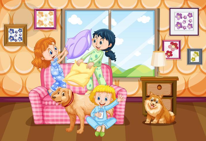 Tre bambini con due cani a casa