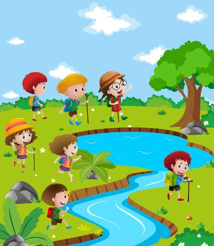 Children hiking up the river
