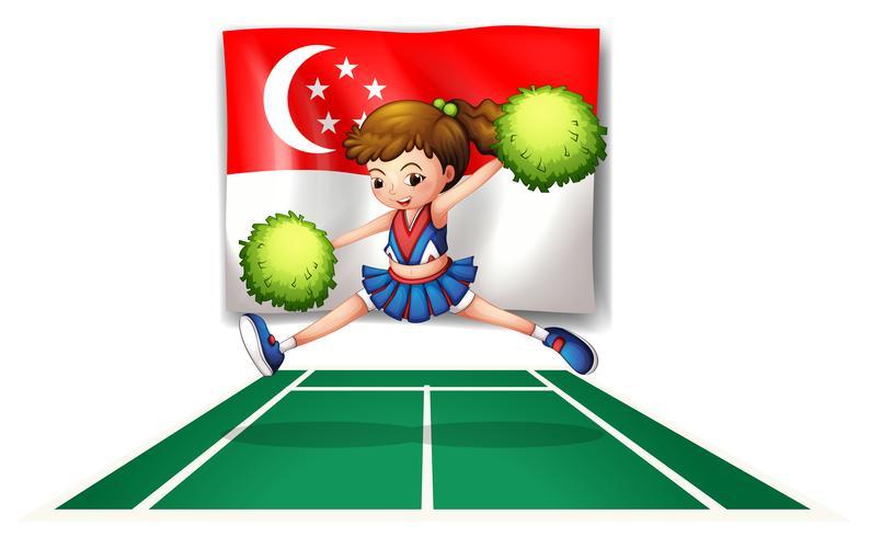 Uma líder de torcida com pompons verdes e a bandeira de Singapura