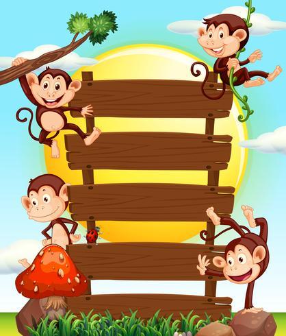 Apen op houten borden