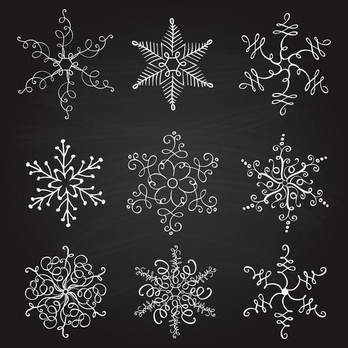 set of nine vintage vector illustration christmas snowflakes on chalkboard background. flourish calligraphic handmade
