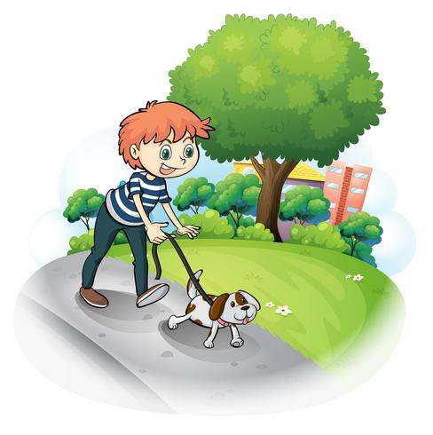 A boy walking with his dog along the street