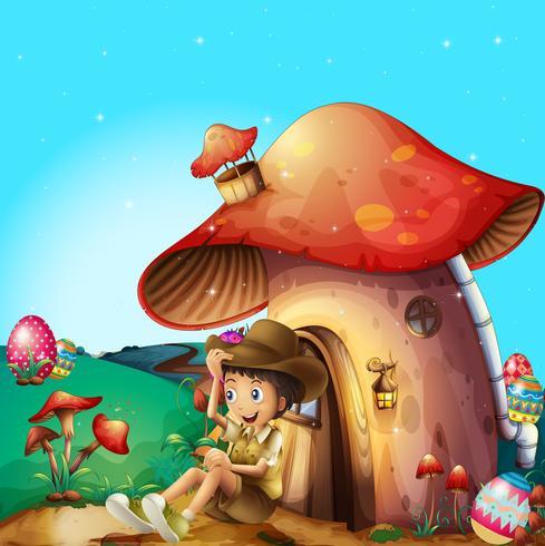 Un garçon à sa maison aux champignons