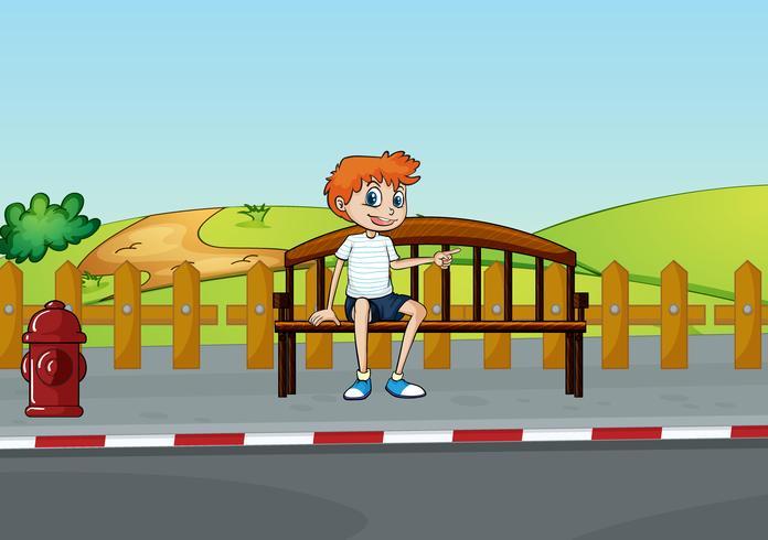 En pojke som sitter på bänken vektor