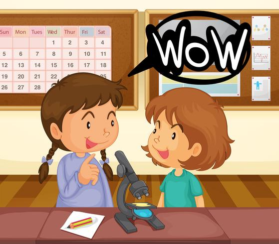 Two girls looking at microscope in classroom