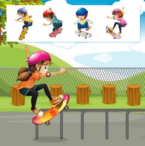 Bambini che giocano a skateboard nel parco