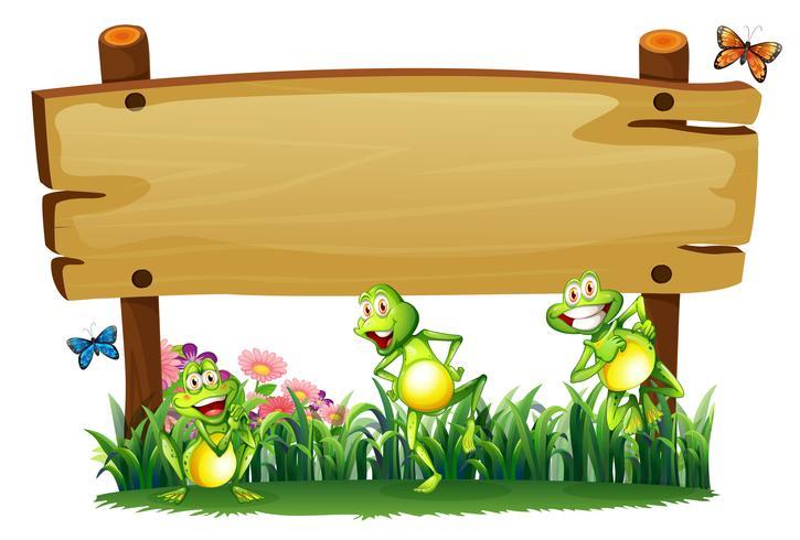 Una tabla de madera vacía en el jardín con ranas juguetonas