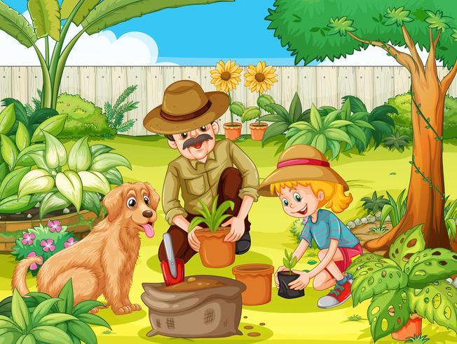 Padre e figlia che piantano albero in giardino