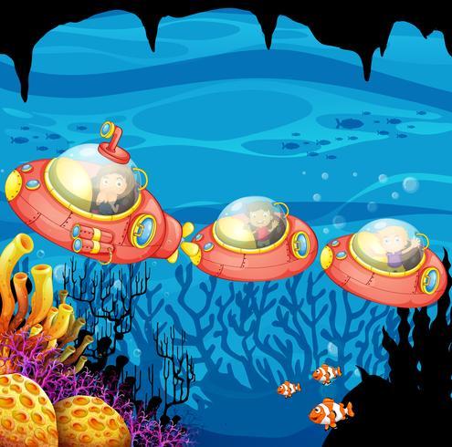 Children riding submarine underwater