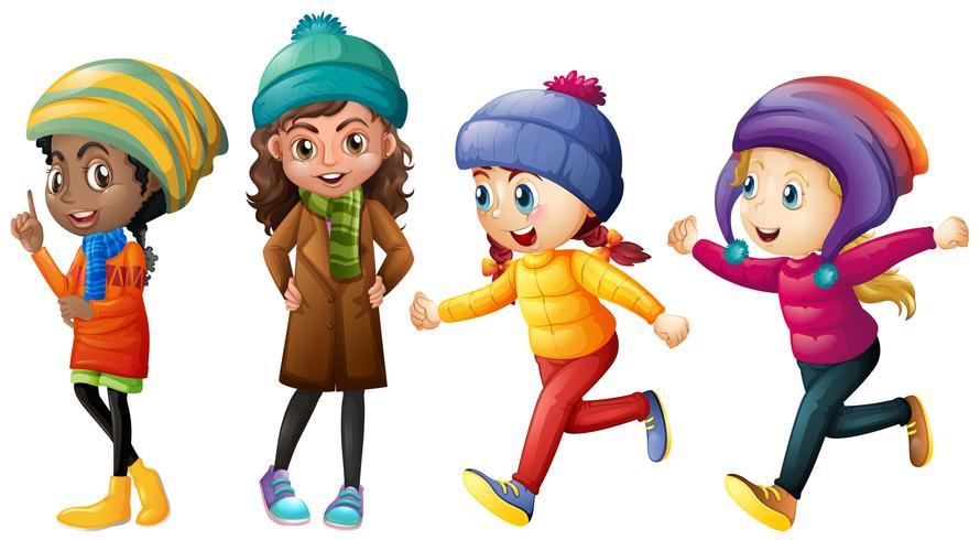 Fyra söta tjejer i vinterkläder