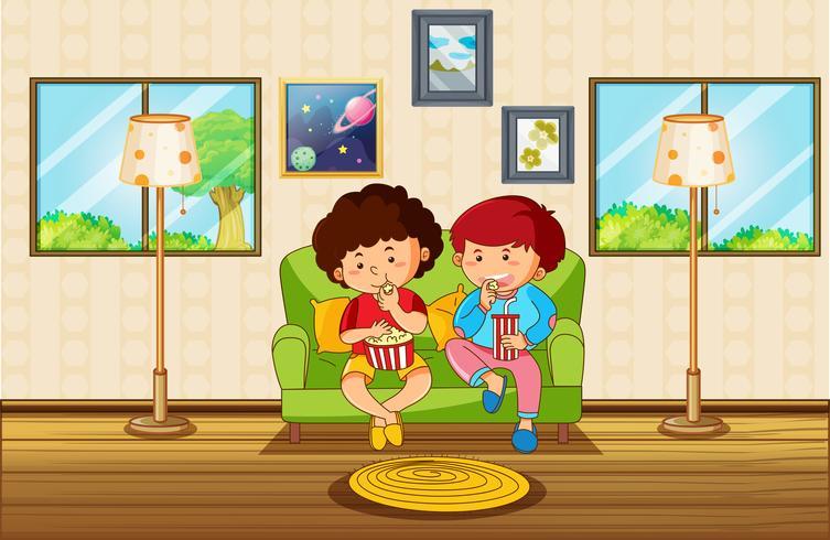 Scena del salone con due ragazzi che mangiano spuntino