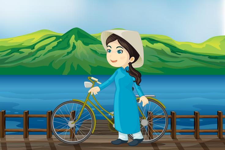 Een meisje met fiets op een bankje