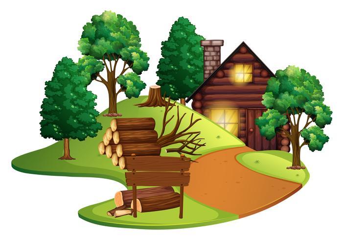 Cabaña de troncos con muchos árboles.