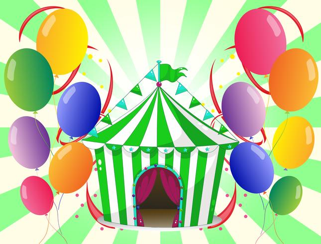 A green circus tent at the center of the colorful balloons