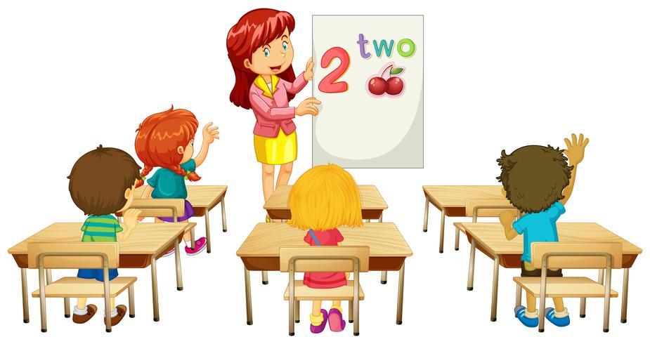 Math teacher teaching children in class
