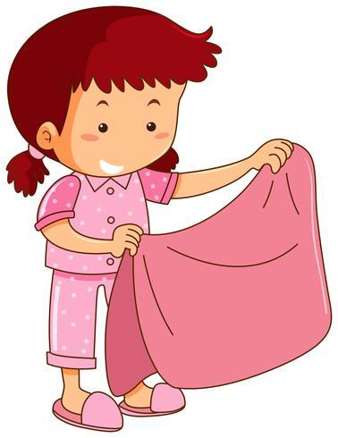 Ragazza in pigiama rosa che tiene coperta rosa