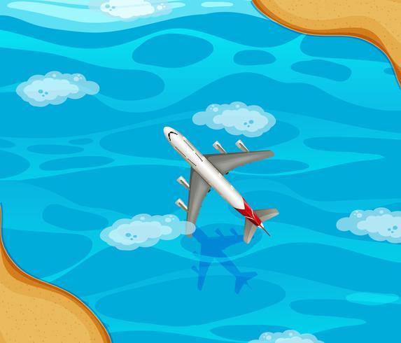 Ett flygplan som flyger över havet