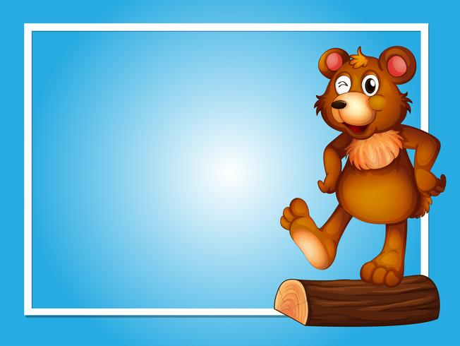 Border template with brown bear on log