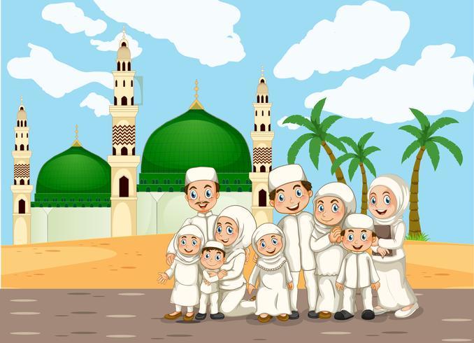 En muslimsk familj framför moskén