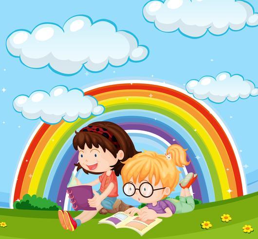 Meisjes die boek in park met regenboog in hemel lezen