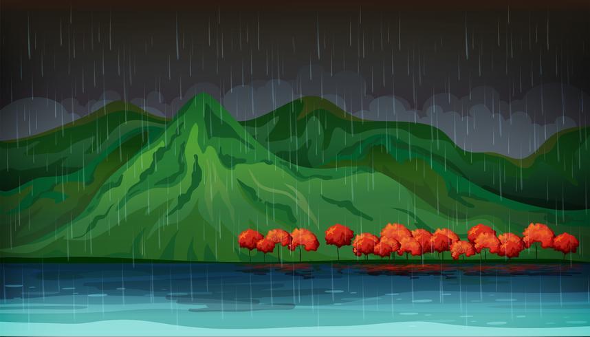 Scena della natura con alberi rossi e grande lago