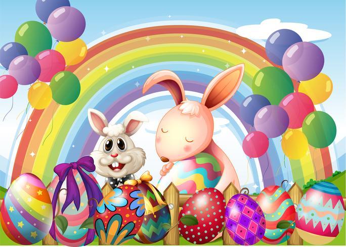 Conigli e uova colorate vicino all'arcobaleno e palloncini galleggianti