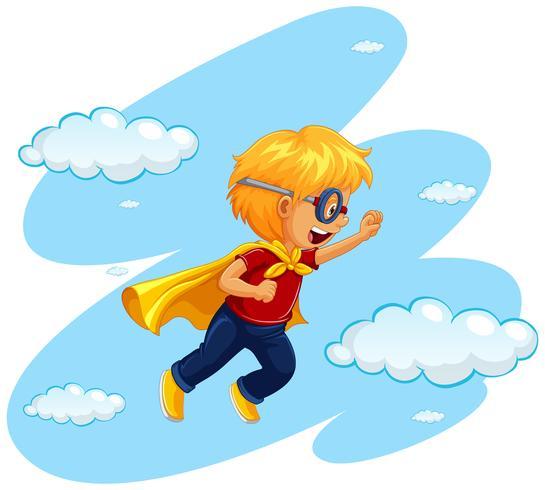 Jongen in heldenkostuum die in hemel vliegen