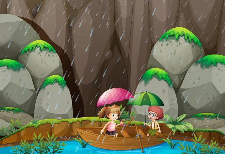 Jungen- und Mädchenruderboot am regnerischen Tag