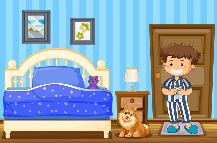 Boy and dog in blue bedroom