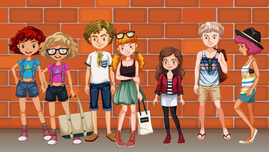 Hipster-pojkar och tjejer hänger på gatan
