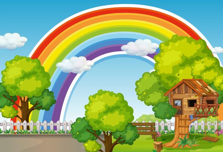 Escena de fondo con arcoiris y casa del arbol