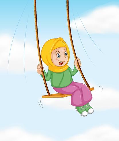 Ein muslimisches Mädchen auf Schaukel