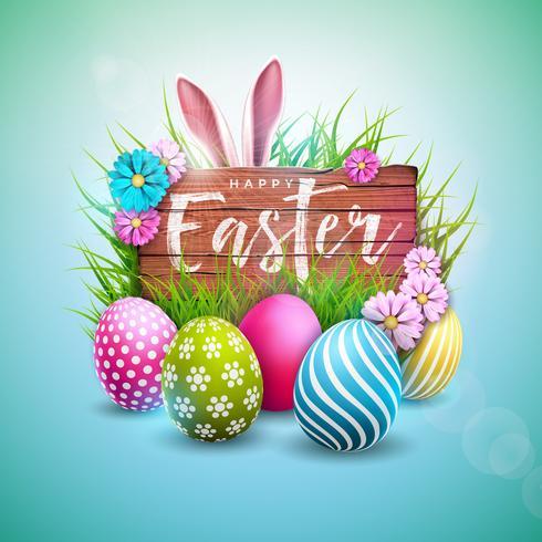 Progettazione felice di festa di Pasqua con le orecchie dipinte dell'uovo, del fiore e di coniglio su fondo di legno d'annata