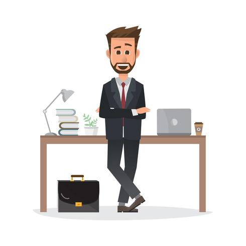 smiling businessman is standing and working on a laptop computer in his office