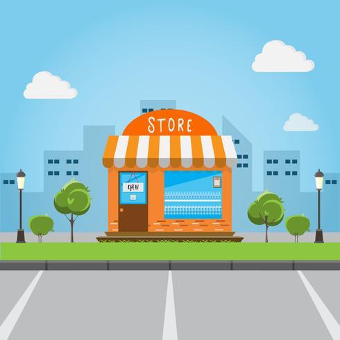 butik främre byggnad med stor stad bakgrund.