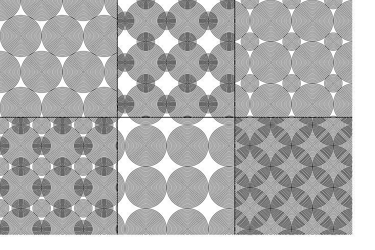 Círculos concéntricos en blanco y negro con motivos geométricos.