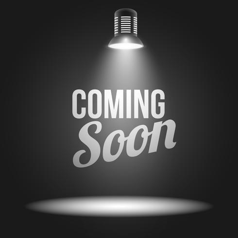 Coming soon message illuminated with light projector vector