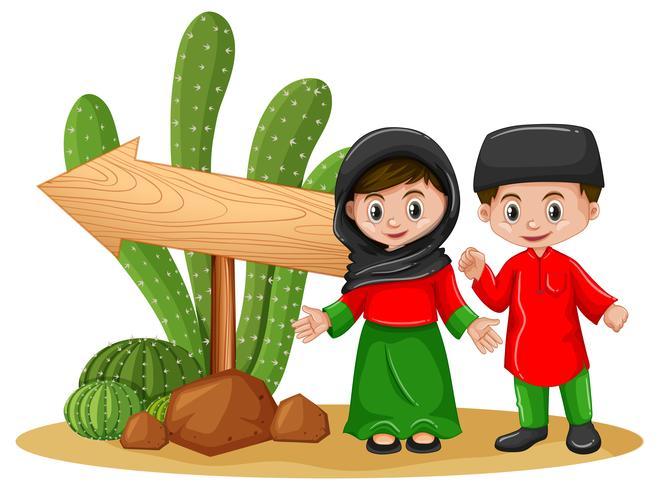 Bambini musulmani e freccia di legno