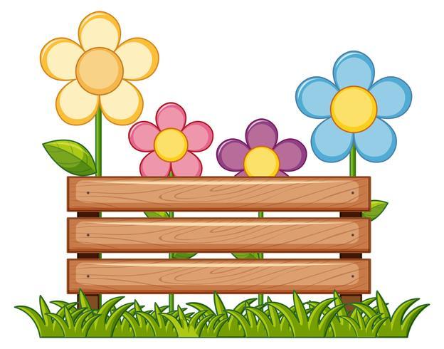 Holzschild mit Blumen im Garten
