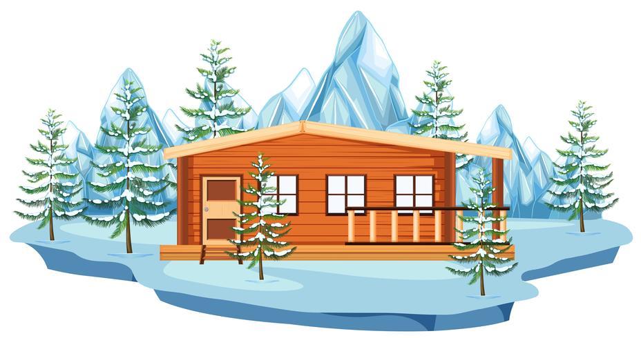 Cottage in legno nel campo di neve