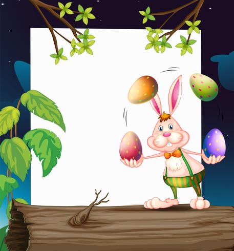 Um modelo vazio com um coelho fazendo malabarismos com os ovos
