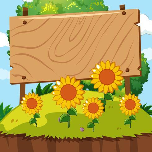 Panneau en bois dans le jardin de tournesol