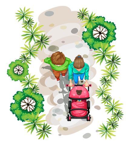 Eine Topansicht einer Familie, die im Park spazieren geht