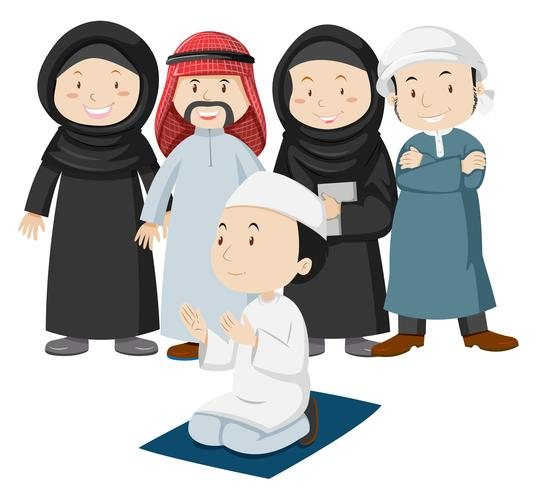 Muslimska folk i traditionell outfit